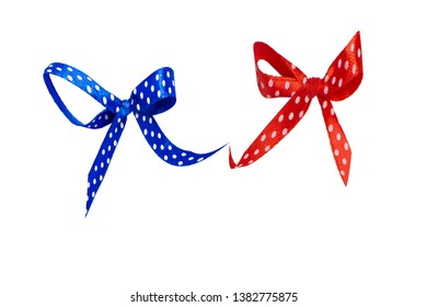 Blue and red satin bow with polka dots.