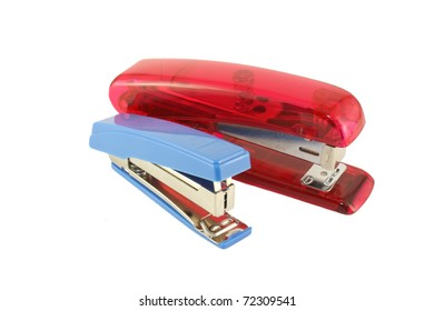 Blue and red staplers over white