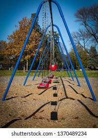 Blue and red swing set.