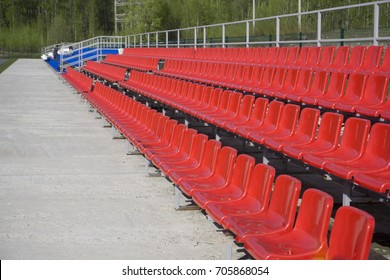 blue, red, white rows of seats on the stadium