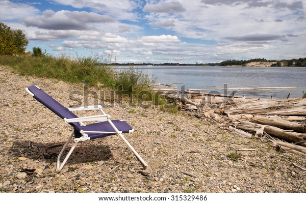 Wondrous Blue Redoing Lawn Chair On Rocky Stock Photo Edit Now Pdpeps Interior Chair Design Pdpepsorg