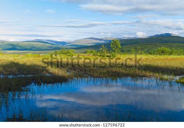 Blue reflections in a pond in the mountain, Troms Norway