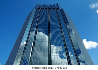 Blue Reflective Glass Skyscraper Reflecting Clouds