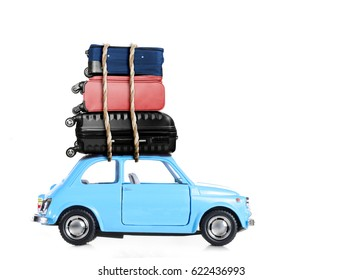Blue retro toy car with travel cases.