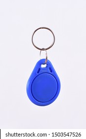 Blue RFID Keychain on the white background, radio-frequency identification