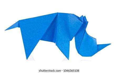 Blue rhinoceros of origami, isolated on white background.