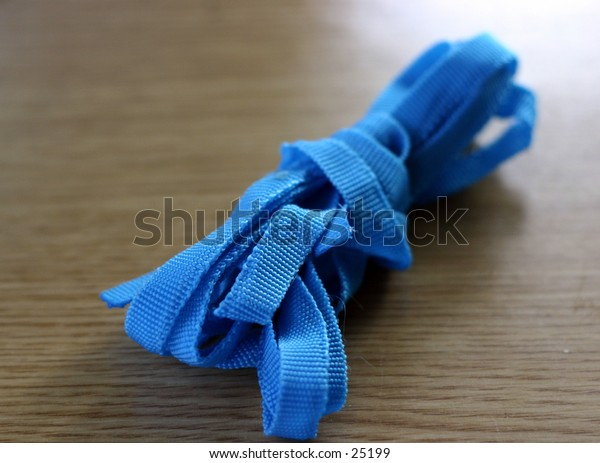 blue ribbon on a table, shallow DOF
