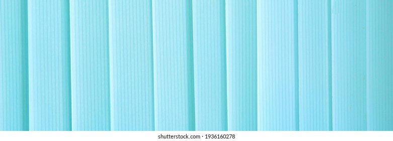 Blue ribbons closed the vertical window blinds. Abstract widescreeen panoramic view background.