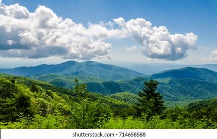 Blue Ridge Mountains located in North Carolina, USA. Beautiful scenic travel destination location. Puffy clouds above Appalacian Mountain Range.
