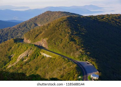 The Blue Ridge Parkway road cutting through the Appalachian Mountains near Asheville, North Carolina. View from the Craggy Pinnacle Trail