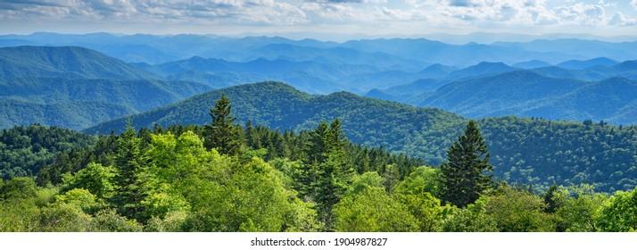 Blue Ridge Parkway summer Landscape. Beautiful summer mountain panorama.  Green mountains and layers of  hills. Near Asheville, North Carolina. Blue Ridge Parkway.USA.