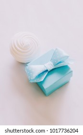 Blue ring box on white background. Marriage proposal. Valentine's Day, Flat lay trendy style.