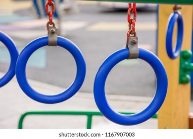 Blue rings on chains on a children's playground in the street