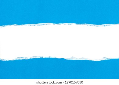 Blue ripped open paper on white paper background.