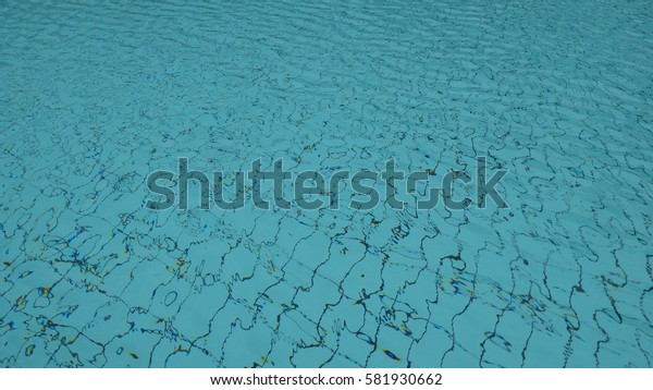 Blue ripped water in swimming pool. low light