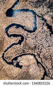 Blue river and brown swamps, aerial view