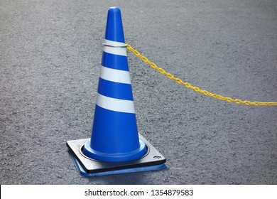 Blue road cone on the street