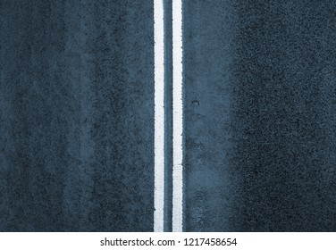 Blue road markings on asphalt on the street of Manhattan in New York City