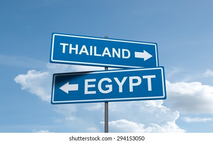 Blue road sign of Thailand and Egypt countries direction arrow on sky background may use for travel design