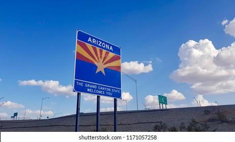 Blue road welcome sign Arizona on California state border, USA