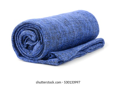 Blue rolled blanket isolated on white