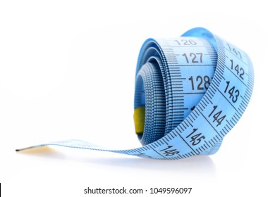 Blue rolled measuring tape isolated on white background. Handicraft and tailoring concept. Measuring tape of tailor with indicators in form of centimeters. Rolled centimeter ruler of blue color.