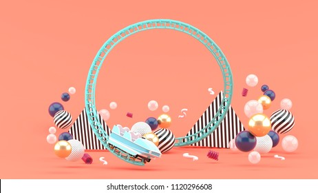 A blue roller coaster among colorful balls on a pink background.-3d rendering.