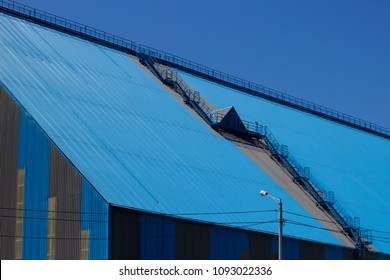 Blue roof of the building. The roof of the plant.