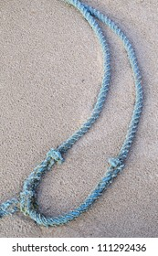 A blue rope on the beach