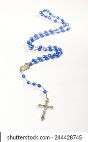 Blue rosary isolated vertical photo