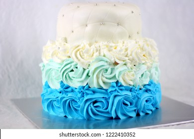 Blue rose swirl buttercream cake with ombre style wedding cake. selective focus