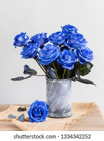 Blue roses in a vase on the table