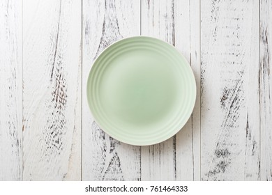 Blue Round Plate on white wooden table background