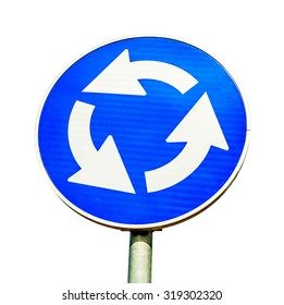 Blue roundabout crossroad road traffic sign isolated on white