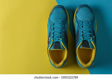 Blue Running boots top view. sport shoes with a Blue and Yellow background with copy space on the right