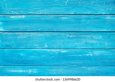 Blue rustic wooden planks painted crackled turquoise paint, top view with copy-space