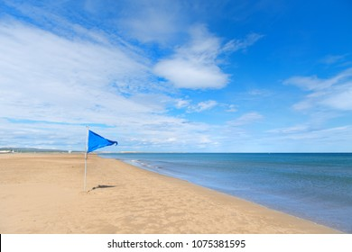 Blue safety flag on Gruissan plage in French languedoc-Roussillon