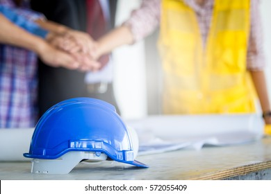 Blue safety helmet in team work concept of engineer close up.