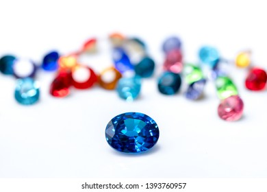 Blue sapphire  with group of gems on background