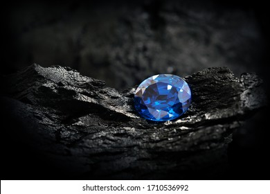 blue sapphire on black coal background