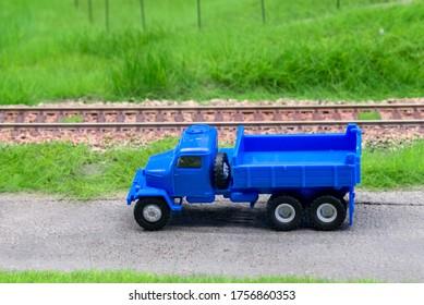 Blue scale truck on model train railroad layout road