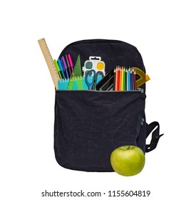 Blue school bag, backpack and apple. Contains watercolor, ruler, color pencils, calculator, notebook, protractor, scissors. Isolated on white.