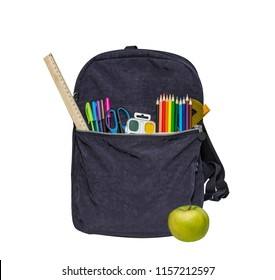 Blue school bag, backpack and apple. Contains watercolor, ruler, color pencils, protractor, scissors. Isolated on white.