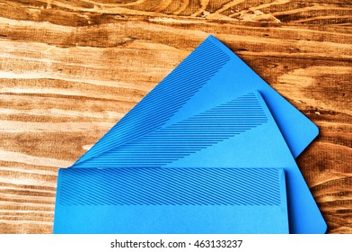 Blue school notebooks on a wooden table.