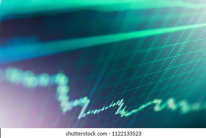 Blue screen of finance data. Stock market graph on the screen. A metaphor of international financial consulting. Financial statistic analysis on dark background with growing financial charts.