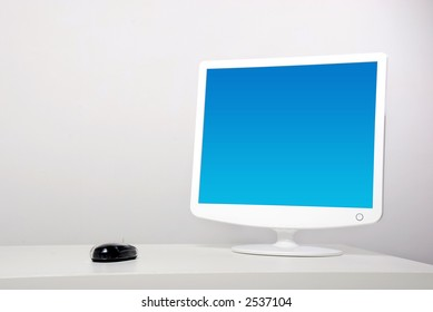 Blue screen monitor on the table - still life shot
