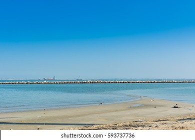 Blue sea and beach with blue sky at the corniche park in Dammam, Kingdom of Saudi Arabia