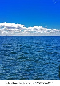 The blue sea with clouds and blue sku