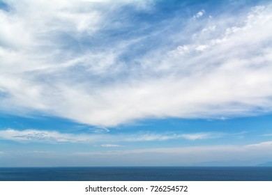 blue sea horizon and white clouds backround