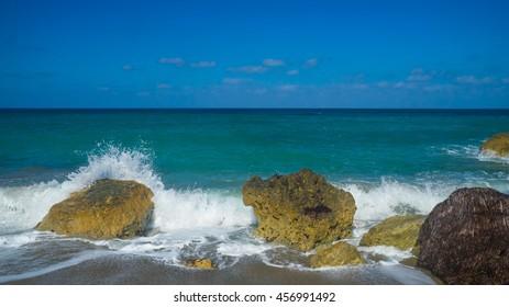Blue sea landscape with rocks and sea foam